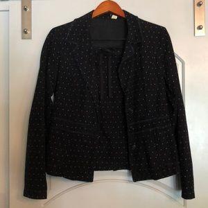 Black polka dot corduroy suit.